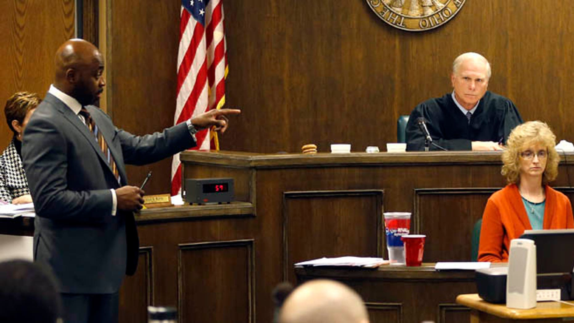 March 16, 2013: Defense attorney Walter Madison, left cross-examines states expert witness, forensic scientist Laureen Marinetta, right, as Judge Thomas Lipps, center, listens on the fourth day of the rape trial against a 17-year-old and 16-year-old in juvenile court in Steubenville, Ohio.