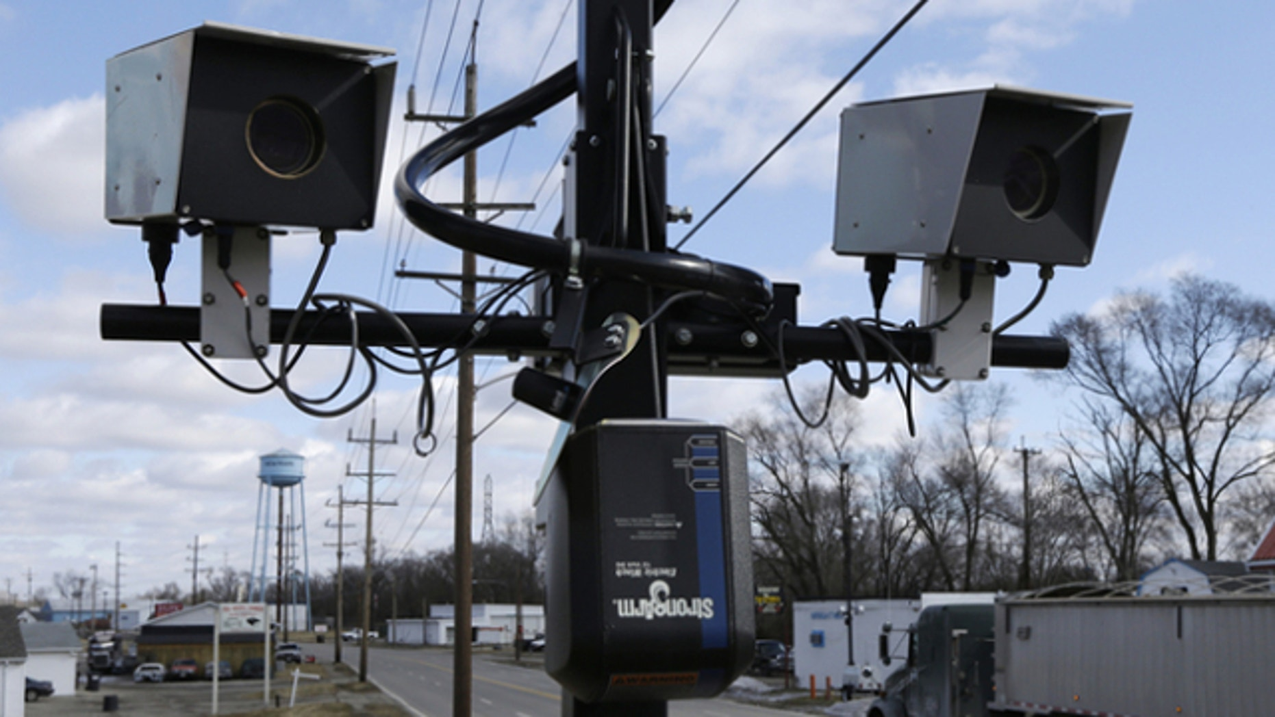 Feb. 25, 2014: Speeding cameras are aimed at traffic moving on US Route 127 in New Miami, Ohio.
