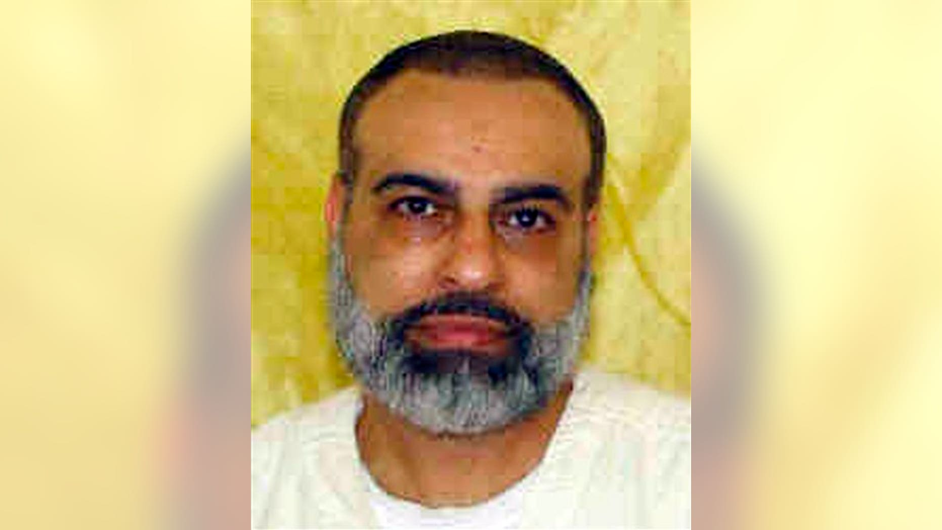 This undated file photo shows Abdul Awkal, convicted in the 1992 slayings of his estranged wife and brother-in-law at a courthouse in Cleveland's Cuyahoga County.