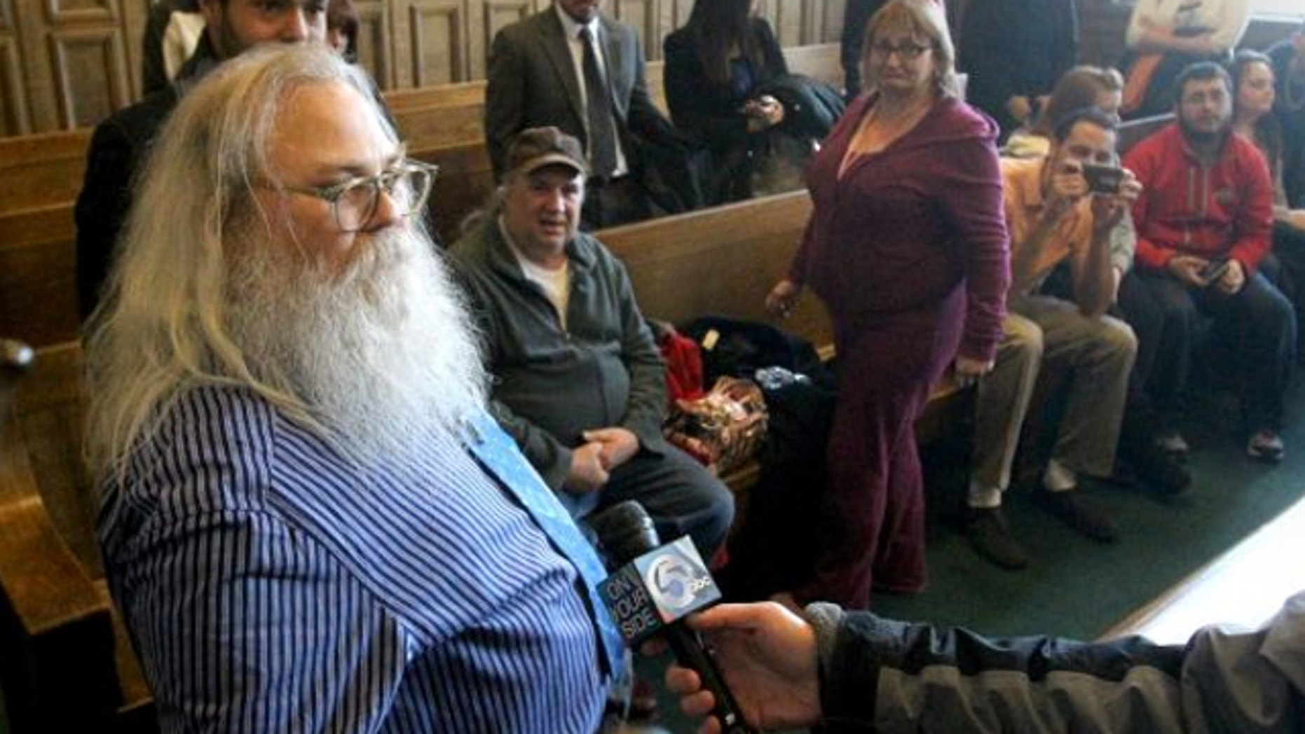 Jan. 30, 2014: Family and friends watch as Dewey Jones, left, speaks to the media after a hearing before Summit County Common Pleas Court Judge Mary Margaret Rowlands in Akron, Ohio.