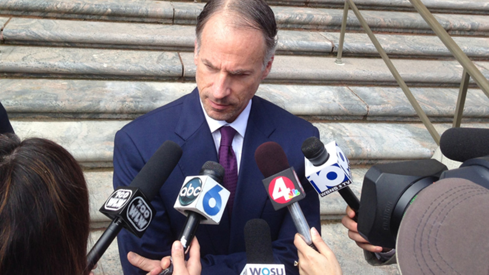 April 17, 2015: Sam Shamansky, defense attorney for accused terrorist Abdirahman Sheik Mohamud, answers questions after Mohamud entered not guilty pleas in federal court to charges of supporting terrorism, supporting a terrorist group and making a false statement involving international terrorism in Columbus, Ohio.