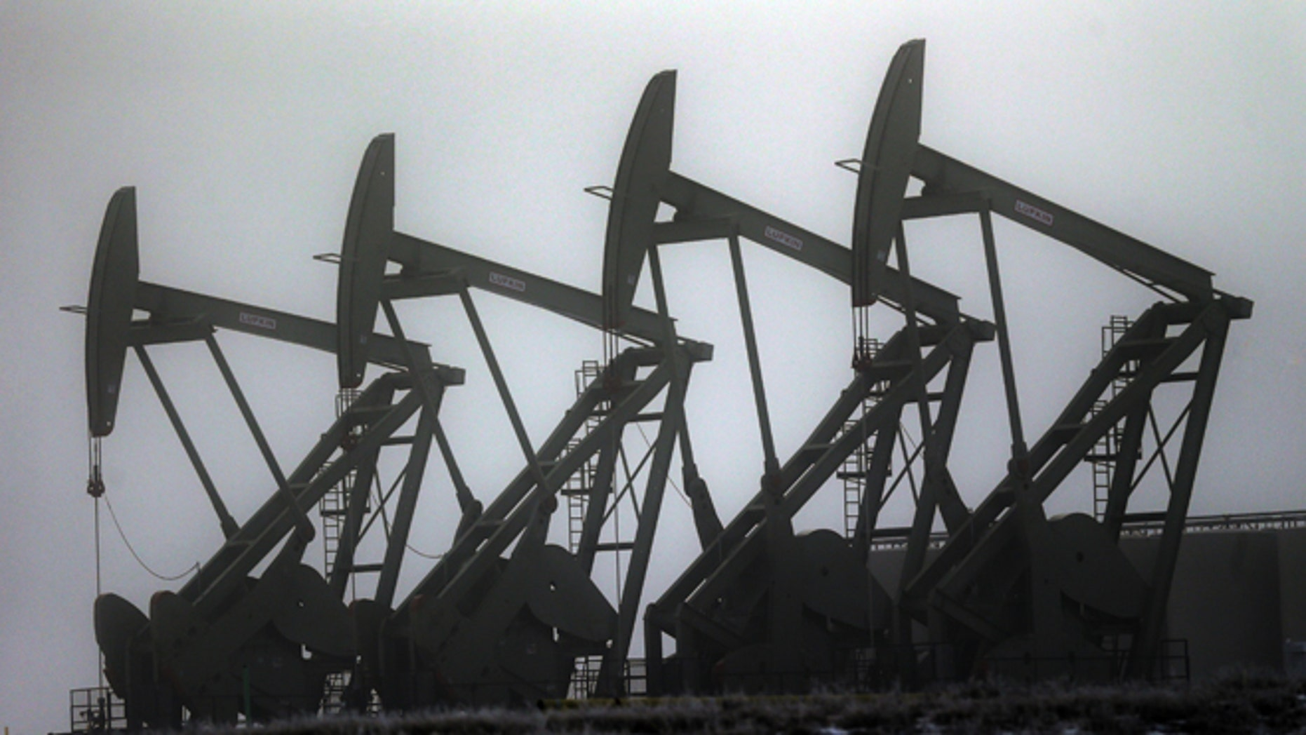 Dec. 19, 2014: Oil pump jacks are shown in Williston, N.D.
