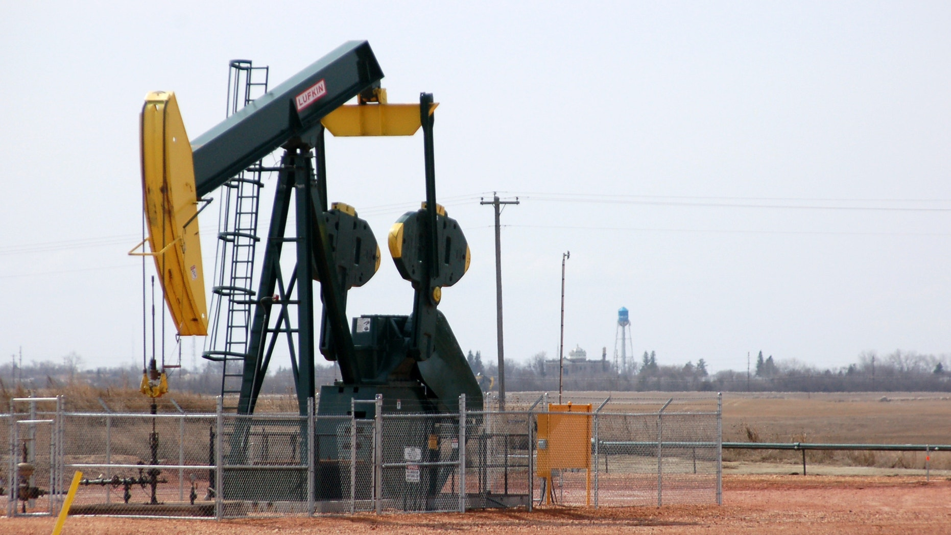 April 7, 2010: One of the many oil pumps scattered near Stanley, N.D. Oil has brought economic prosperity and scores of oilmen to western North Dakota, but now the Williston City Commission has approved the first reading of an ordinance that would make it illegal to live in a camper within city limits. (AP)