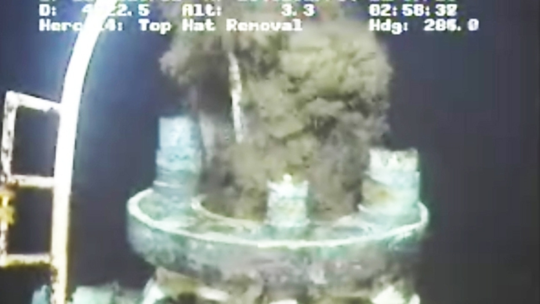 This image from video provided by BP PLC early Sunday, July11, 2010 shows oil continuing to leak after the flange was removed from atop the broken wellhead, at the site of the Deepwater Horizon oil well in the Gulf of Mexico.