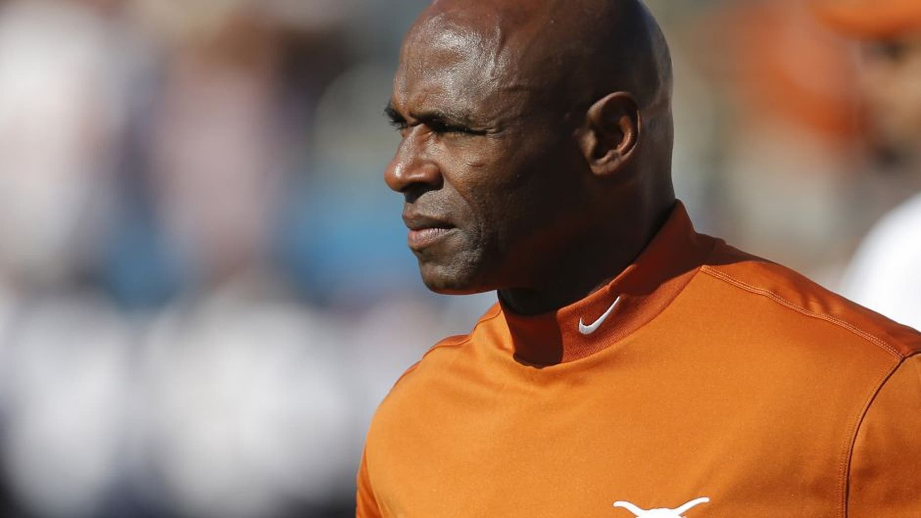 Texas head coach Charlie Strong looks on during warmups before the first half against Oklahoma at the Cotton Bowl in Dallas on Saturday, Oct. 10, 2015. (Brandon Wade/Fort Worth Star-Telegram/TNS via Getty Images)