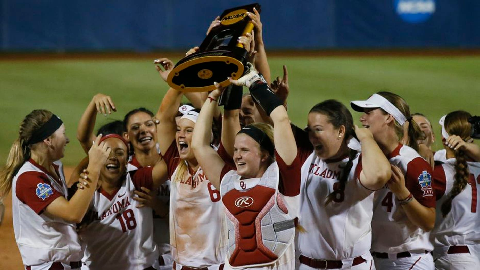 The Oklahoma team celebrates after defeating Florida in the second game of the best-of-three championship series in the NCAA Women's College World Series in Oklahoma City, Tuesday, June 6, 2017. Oklahoma won the game 5-4, and the championship. (AP Photo/Sue Ogrocki)