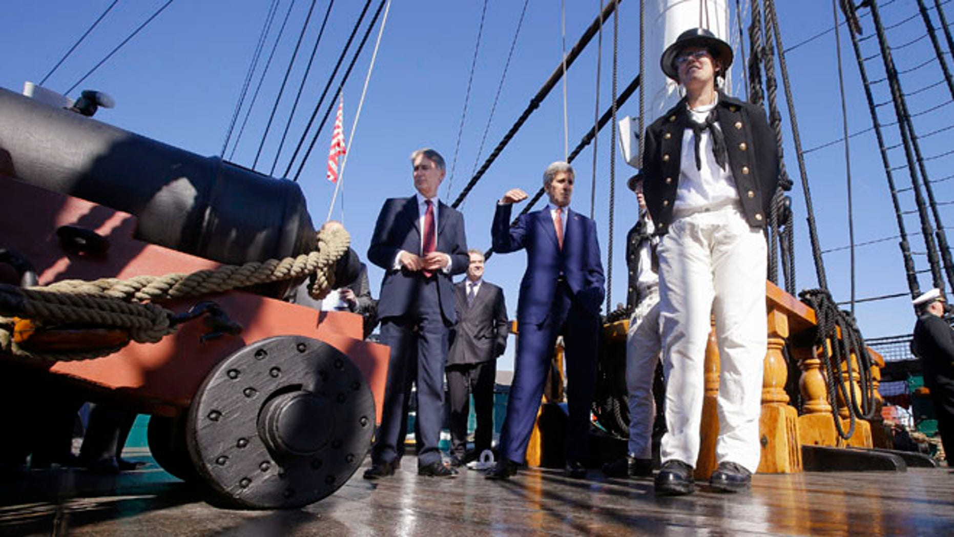 Oct. 9, 2014: Secretary of State John Kerry, center, and British Foreign Secretary Philip Hammond, left, tour the main deck of the USS Constitution, 'Old Ironsides' during a visit to the U.S. Navy's oldest commissioned ship