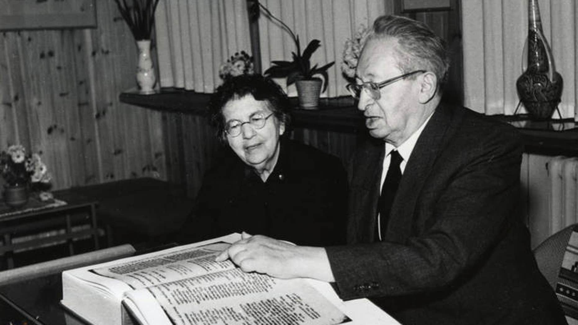 The late president of Israel, Izhak Ben-Zvi, and his wife, Rachel Yanait Ben Zvi, examining a facsimile copy of the Aleppo Codex. (UNESCO)
