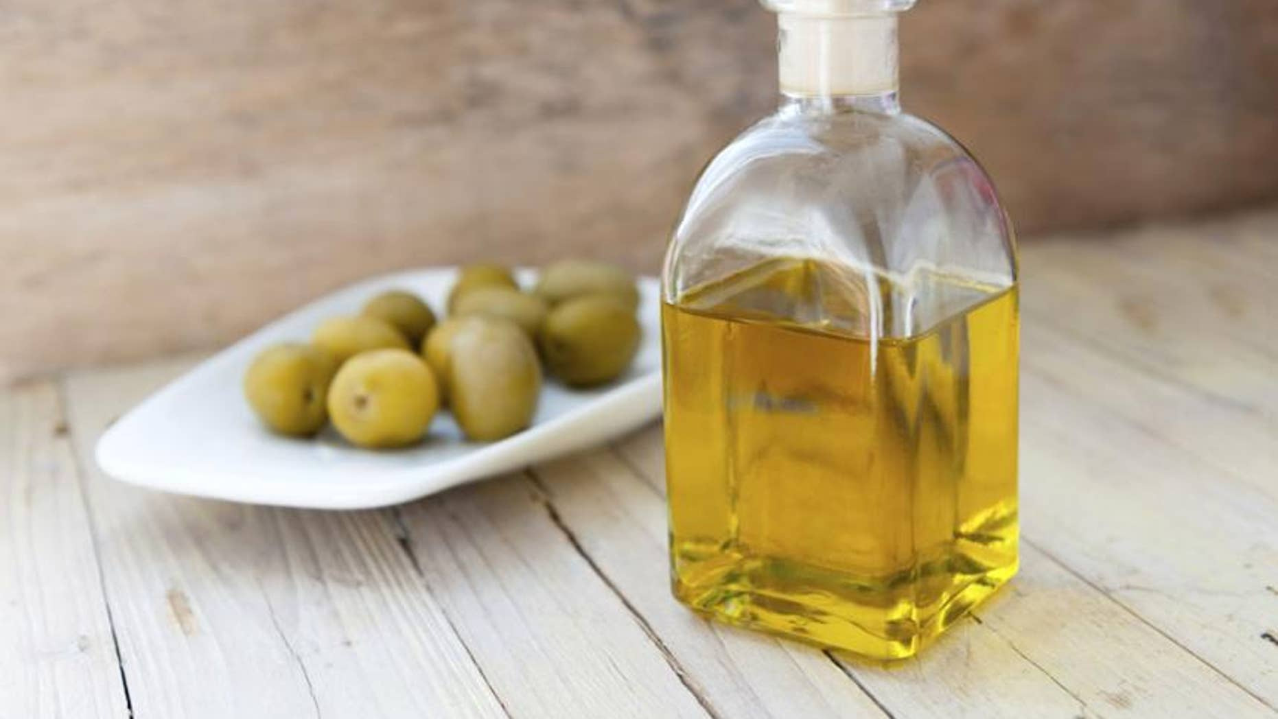 The%20holy%20grail%20of%20monounsaturated%20fat%2C%20EVOO%2C%20is%20literally%20brimming%20with%20health%20boosters%20(and%20that's%20apart%20from%20minimizing%20your%20gut)%2C%20including%20anti-inflammatory%20properties%2C%20cardiovascular%20benefits%2C%20brain-boosting%20benefits%2C%20and%20many%20others.%20Opt%20for%20around%20two%20tablespoons%20a%20day%20%E2%80%94%20an%20easy%20feat%20if%20you%20drizzle%20it%20over%20fresh%20fish%20or%20veggies%2C%20or%20mix%20it%20with%20a%20little%20lemon%20juice%2C%20garlic%20and%20spices%20to%20create%20the%20perfect%20salad%20dressing.%20However%2C%20in%20order%20to%20reap%20the%20benefits%2C%20you%20shouldn%E2%80%99t%20cook%20or%20heat%20up%20olive%20oil%20for%20several%20reasons%2C%20including%20the%20fact%20that%20chemical%20changes%20take%20place%20in%20its%20compound%20and%20could%20be%20harmful%20to%20eat%20and%20breathe.%0A