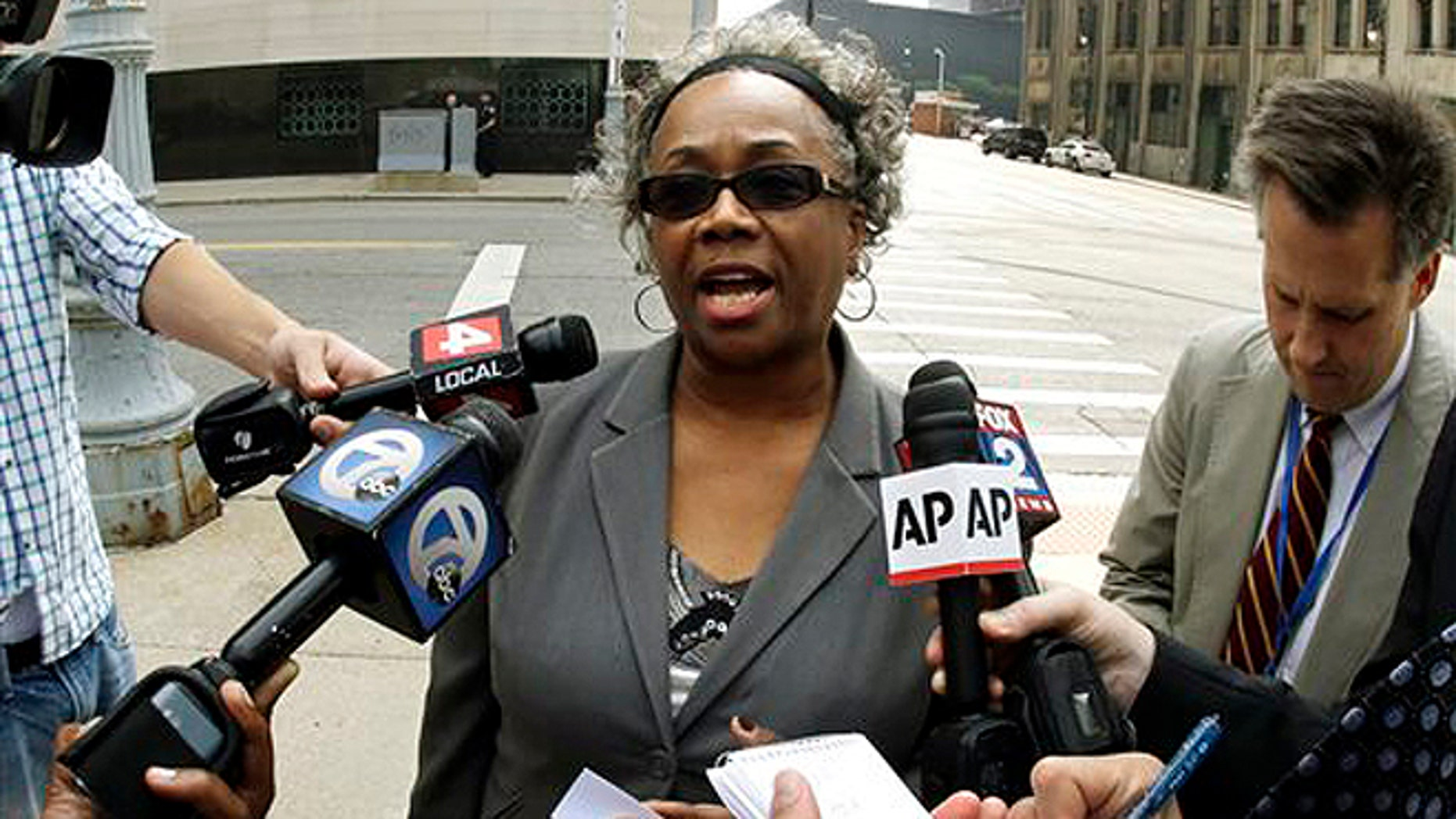 Sept. 19, 2013: Detroit resident Olivia Gillon addresses the media outside federal court in Detroit after attending a Detroit bankruptcy hearing.