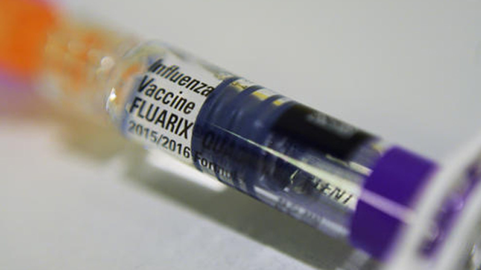 This Thursday, Nov. 12, 2015 file  photo shows a single dosage syringe of the Fluarix quadrivalent influenza virus vaccine in New York. Zika is in the spotlight but there are other bugs and health problems that Olympic athletes and fans should keep in mind, including the flu. (AP Photo/Patrick Sison)