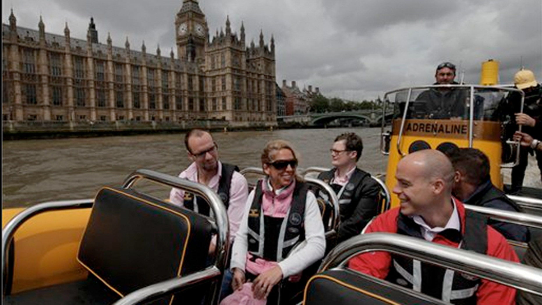 July 4, 2012:  People are seen aboard a high-speed 12-seater rigid inflatable boat, run by the Protection Services International company as it travels past the Palace of Westminster on London's river Thames.