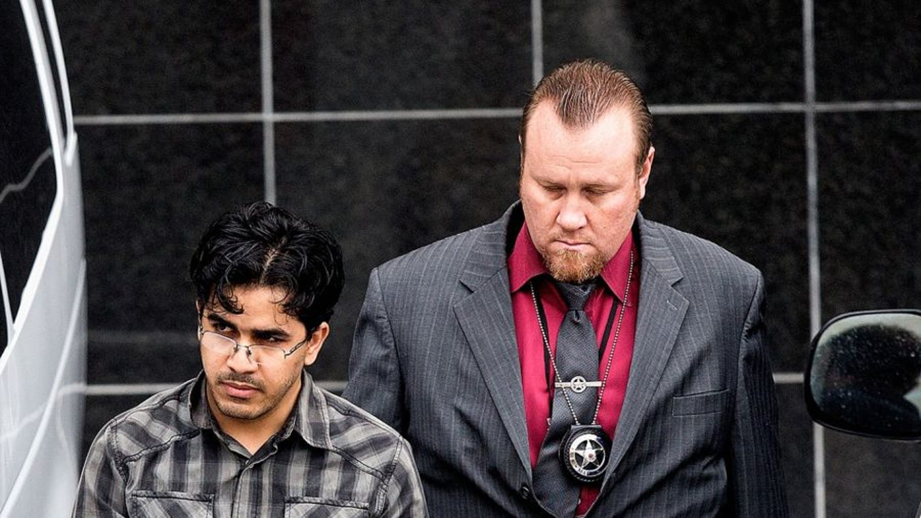 Omar Faraj Saeed Al Hardan, left, is escorted by U.S. Marshals from the Bob Casey Federal Courthouse on Friday, Jan. 8, 2016, in Houston.
