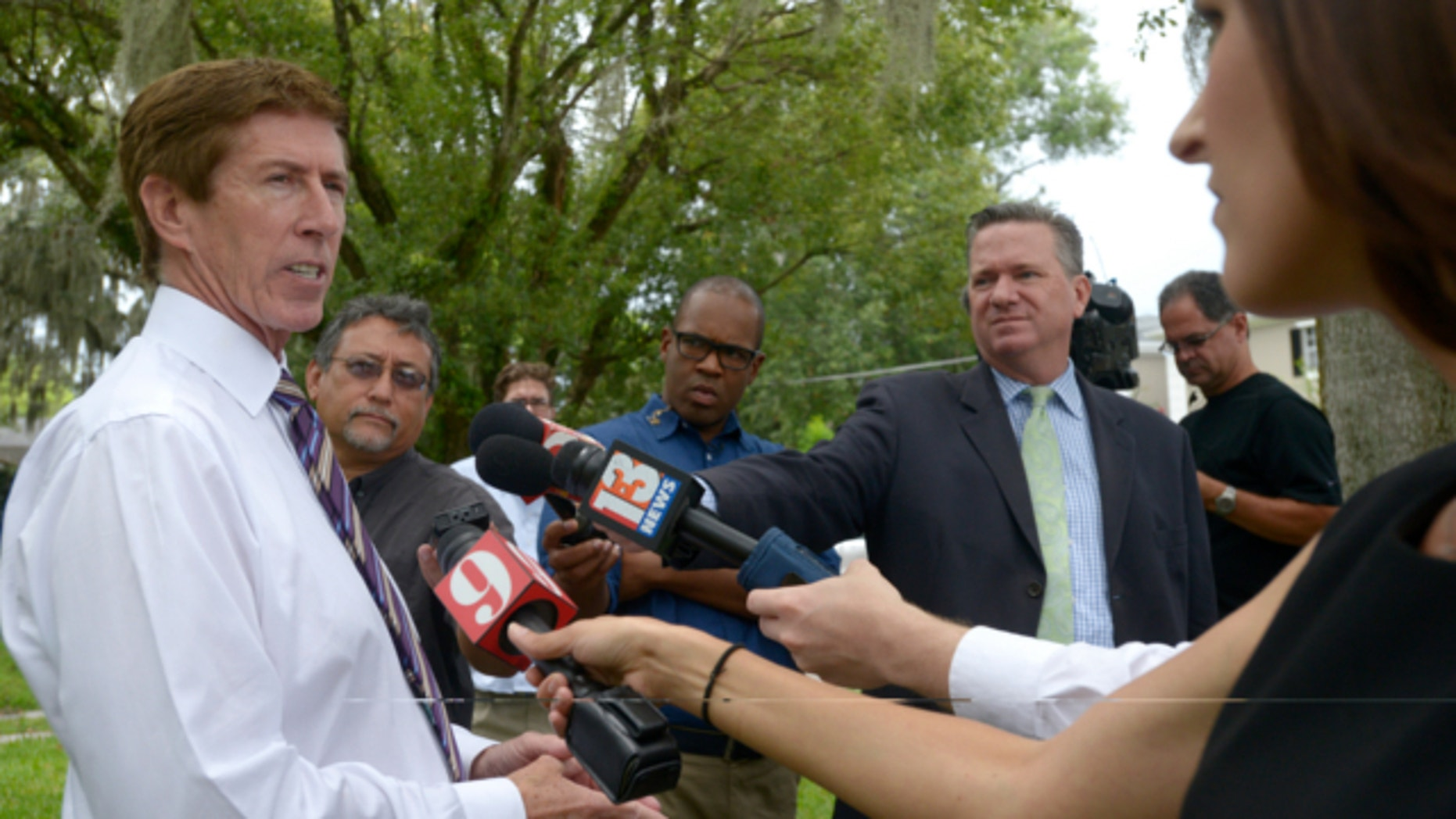July 24, 2013: George Zimmerman attorney Mark O'Mara answers questions from reporters outside his offices in Orlando, Fla.