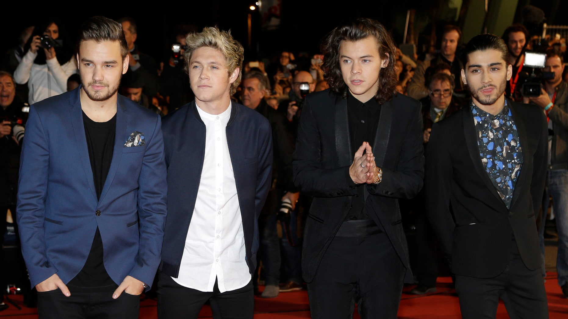 FILE - In this Dec. 13, 2014, photo, English Irish pop boy band One Direction arrives at the Cannes festival palace, to take part in the NRJ Music awards ceremony, in Cannes, southeastern France. The Philippine Bureau of Immigration is requiring two members of the English-Irish band One Direction to post bonds worth nearly $5,000 each, to be forfeited if they are caught using or impliedly promoting illegal drugs while in Manila for their concerts during the weekend of March 21-22, 2015.  (AP Photo/Lionel Cironneau, File)