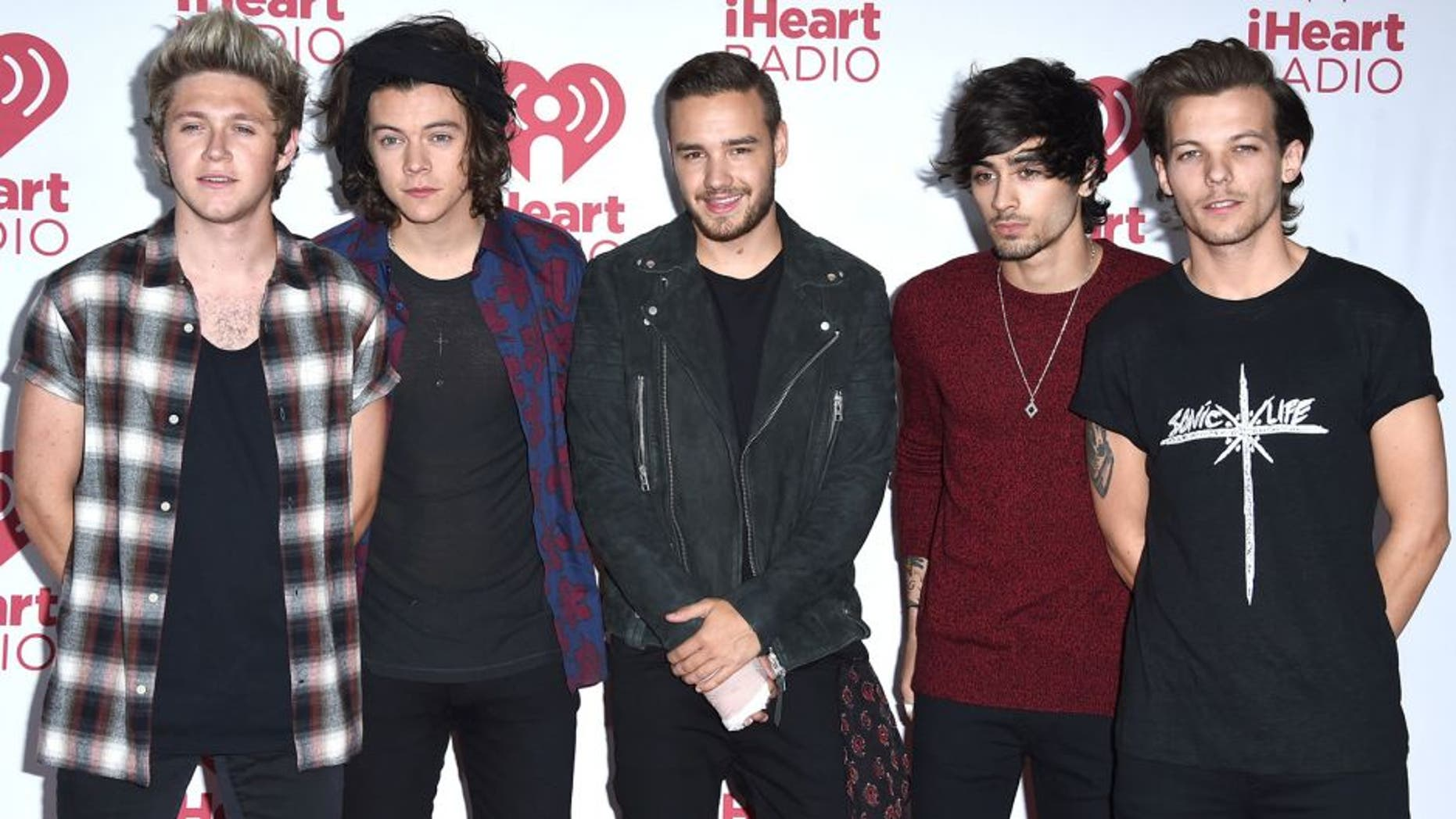 LAS VEGAS, NV - SEPTEMBER 20: One Direction pose in the 2014 iHeartRadio Music Festival - Night 2 - Press Room at MGM Grand Garden Arena on September 20, 2014 in Las Vegas, Nevada. (Photo by Steve Granitz/WireImage)