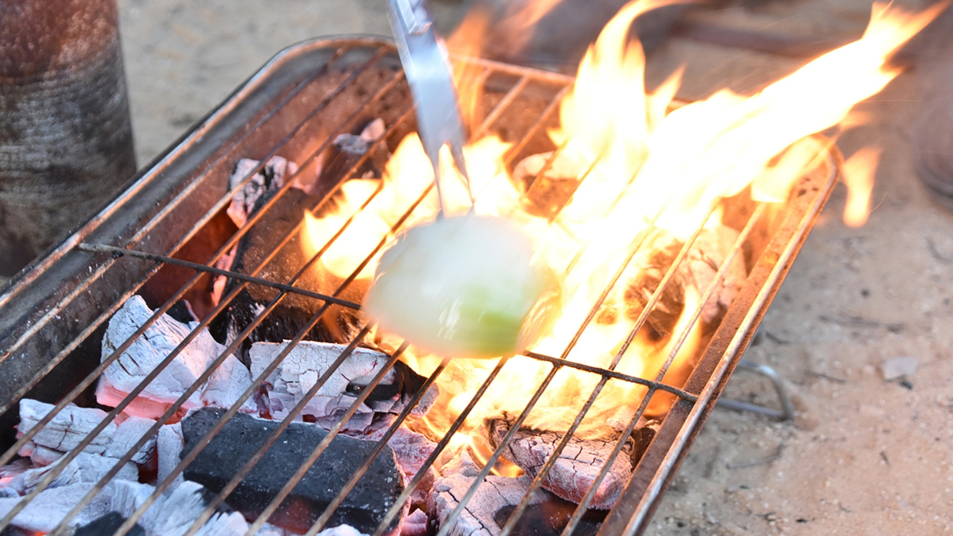 This simple grilling hack makes use of the antibacterial properties of an onion.