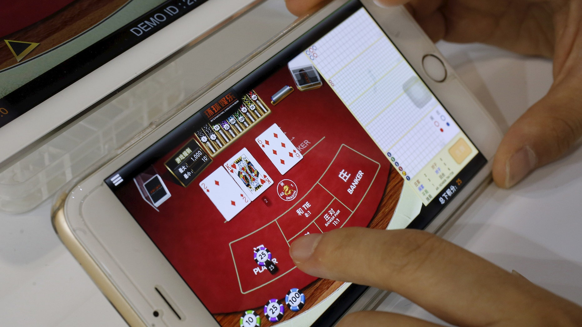 A new report says legal online gambling may be coming back to the U.S. via an audio industry executive. (REUTERS/Bobby Yip)