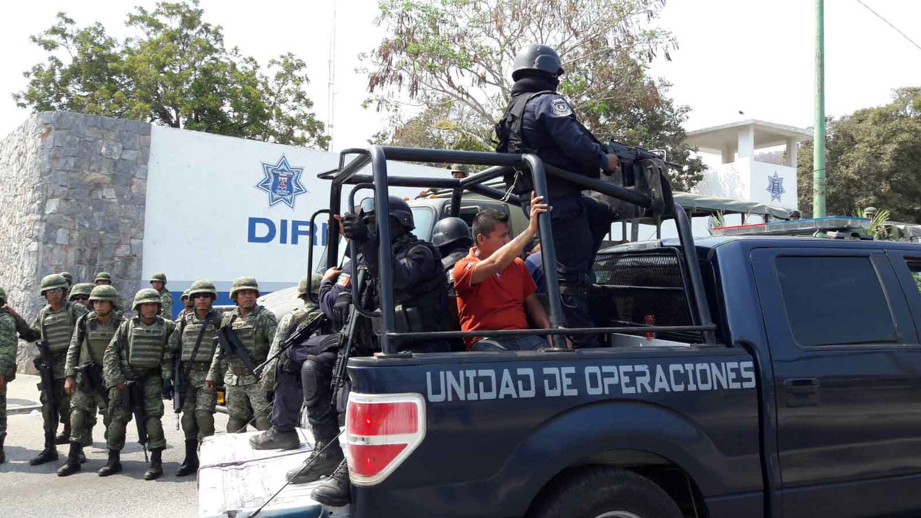 Since last week's operation, the Pacific resort's municipal force has been taken off duty, leaving the state police and Mexican military to patrol the streets.