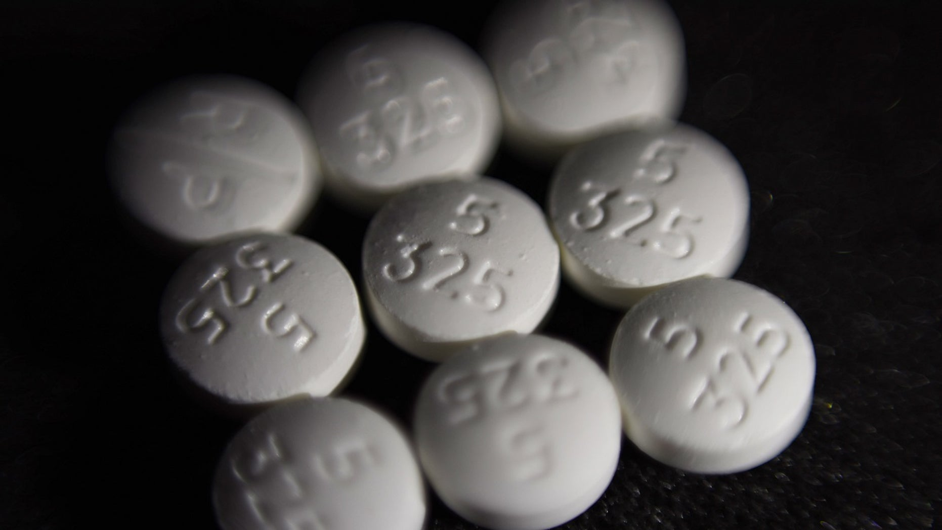FILE Aug. 15, 2017: An arrangement of pills of the opioid oxycodone-acetaminophen, also known as Percocet, in New York. Cities and counties of all sizes have sued companies that make and distribute prescription opioids. Among the plaintiffs so far: Philadelphia; the state of Ohio; Princeton, West Virginia; the Cherokee Nation; and a consortium of counties across Wisconsin.