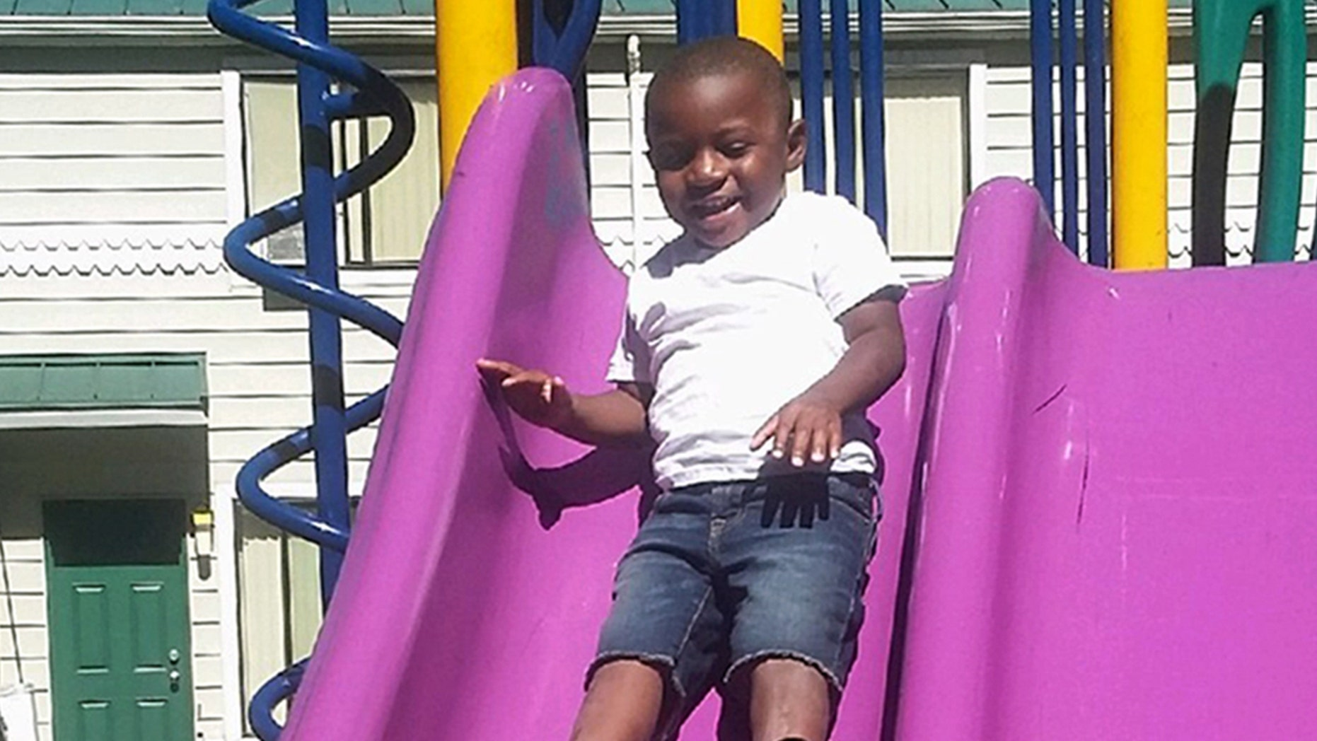 This July 2016 photo provided by Pamela Harris shows Reginald Kendall Harris Jr., playing on a slide at a park in Portland, Ore.