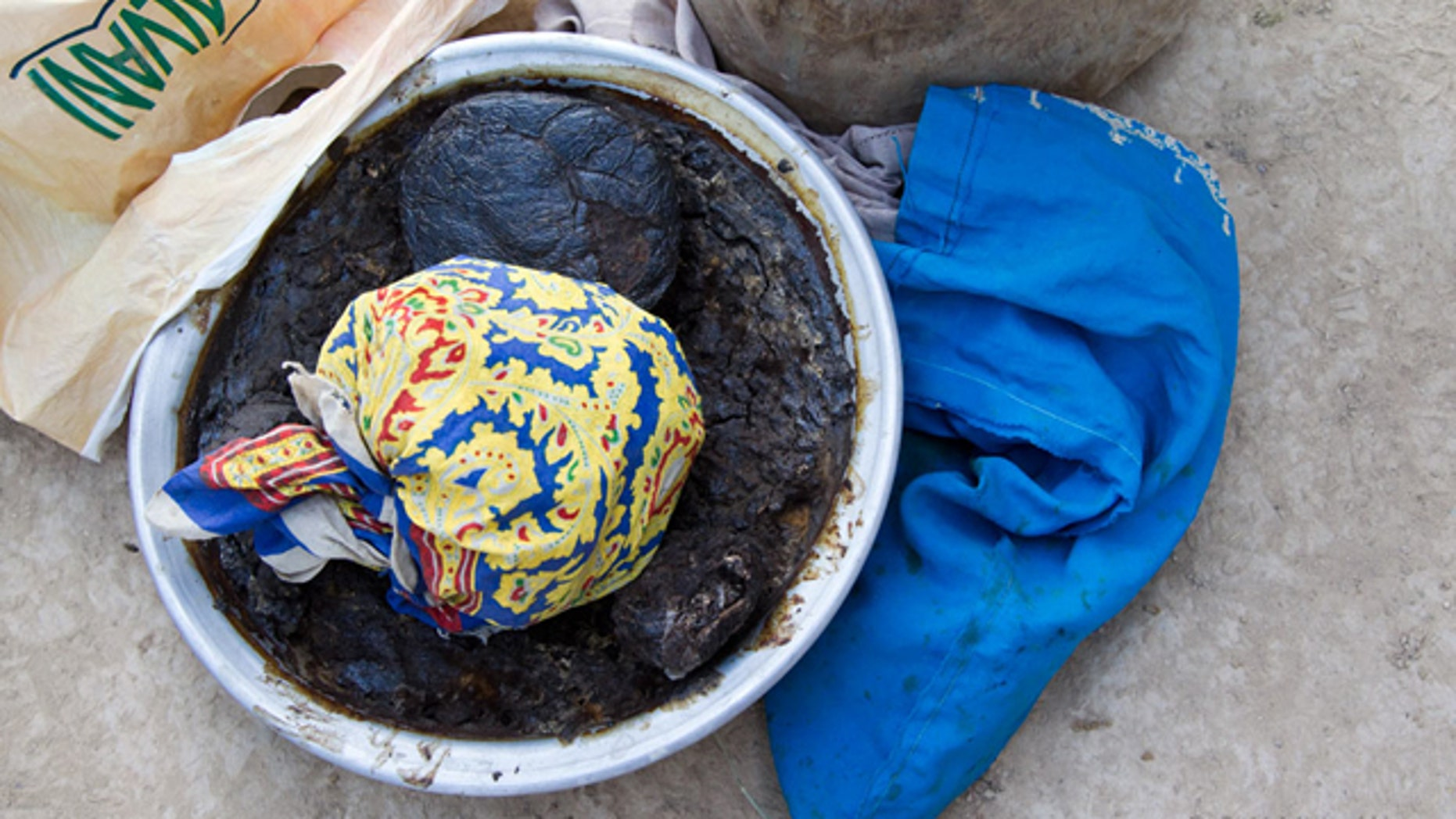 During a mission many weeks ago, a bowl of opium paste like the one seen here was found at a family compound.  The opium has already been harvested and the poppy stalks have been cut down and are dry and hardened.