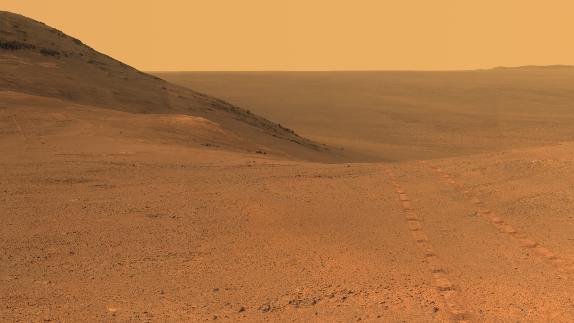 Tracks from NASA's Opportunity rover on Mars are visible on the Martian surface in this image taken in June 2017. After months of silence from Opportunity due to a dust storm on Mars, NASA has begun a 45-day campaign to reestablish contact with the rover.