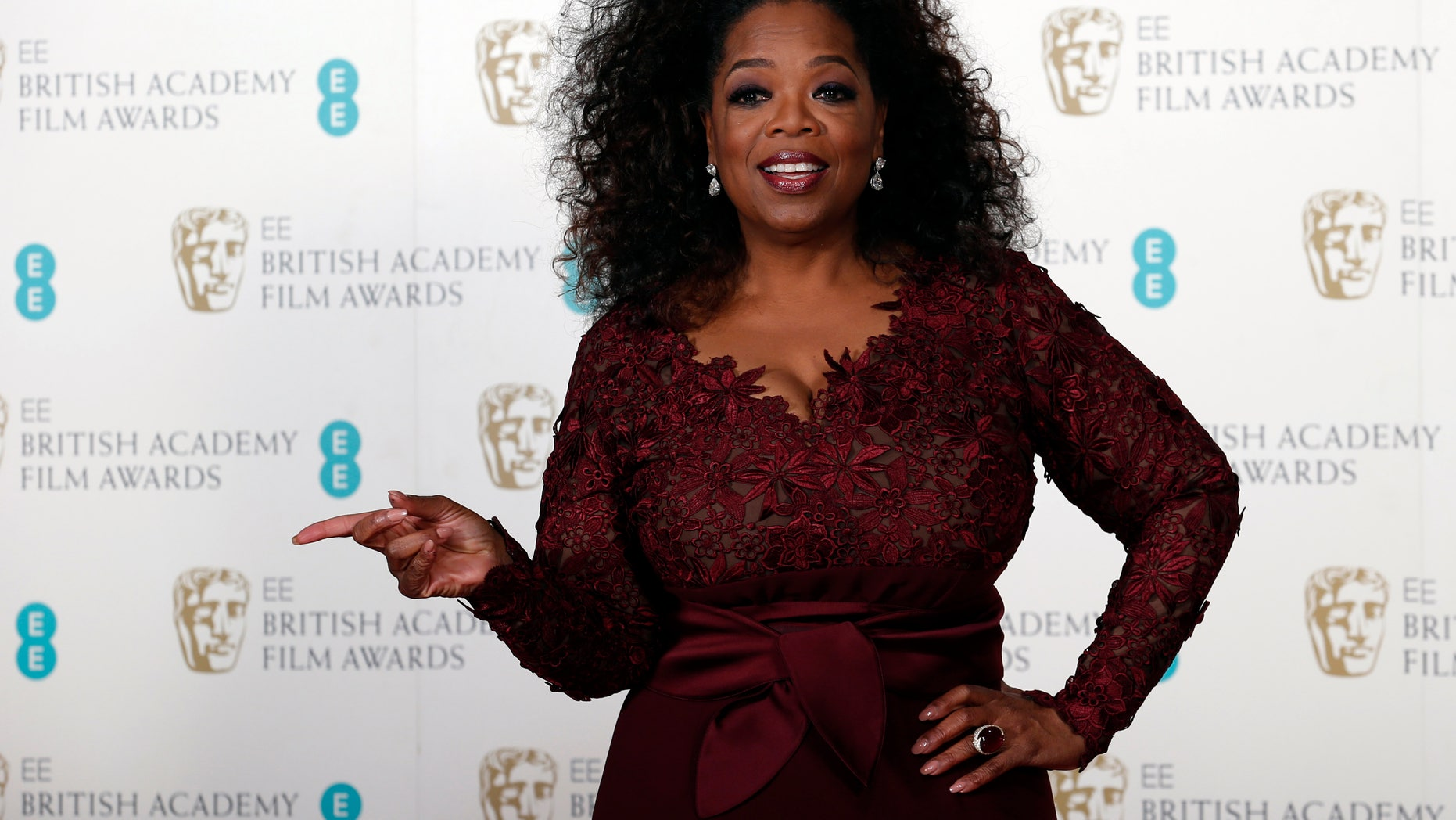 February 16, 2014. Oprah Winfrey poses at the British Academy of Film and Arts (BAFTA) awards ceremony at the Royal Opera House in London.