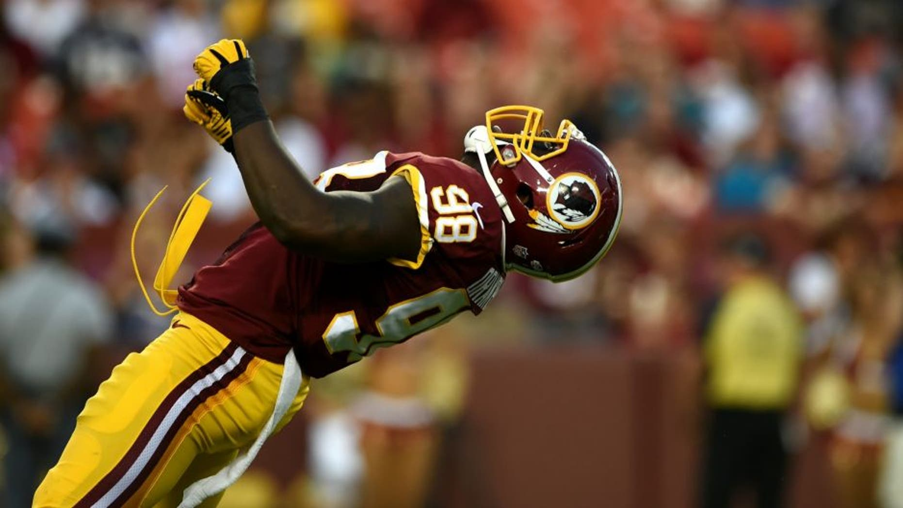 LANDOVER, MD - AUGUST 07: Outside linebacker Brian Orakpo #98 of the Washington Redskins celebrates after sacking quarterback Ryan Mallett #15 of the New England Patriots (not pictured) in the first quarter during a preseason NFL game at FedExField on August 7, 2014 in Landover, Maryland. (Photo by Patrick Smith/Getty Images)
