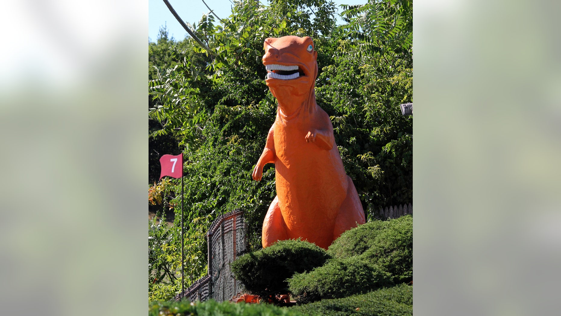In this Monday, Sept. 12, 2016 photo, a 20-foot-high orange dinosaur stands near Route 1 in Saugus, Mass. Some feared the 20-foot dinosaur would disappear because the miniature golf course on which it has stood since 1958 was sold to a developer.