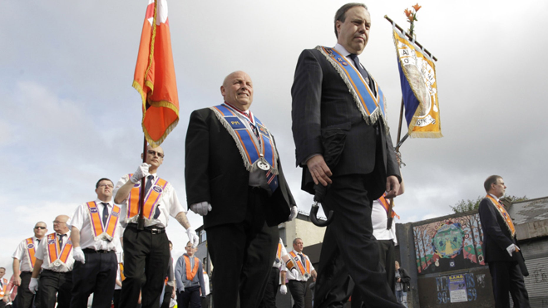July 12, 2012: Orange Order members march past the mainly Catholic Ardyone area of North Belfast, Northen Ireland.