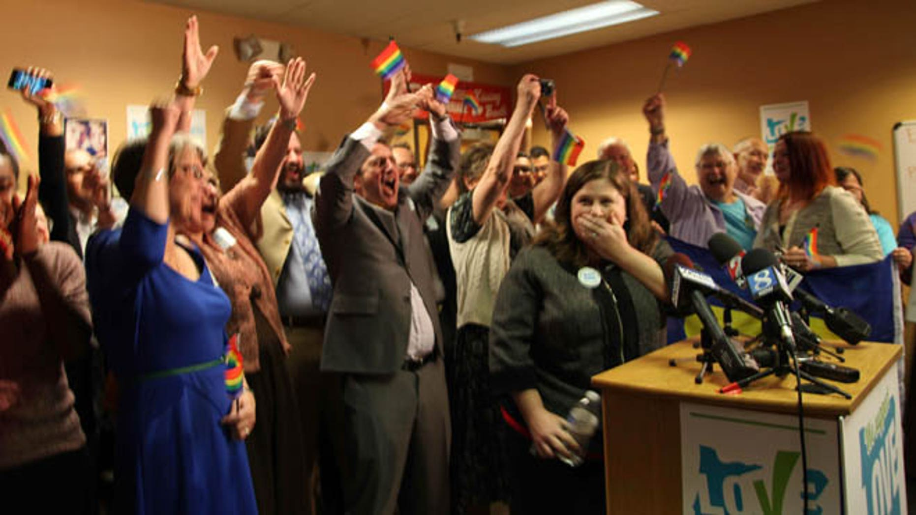 May 19, 2014: Gay and lesbian couples and their supporters react to the news of a federal judge striking down Oregon's ban on same-sex marriage, in Portland, Ore.