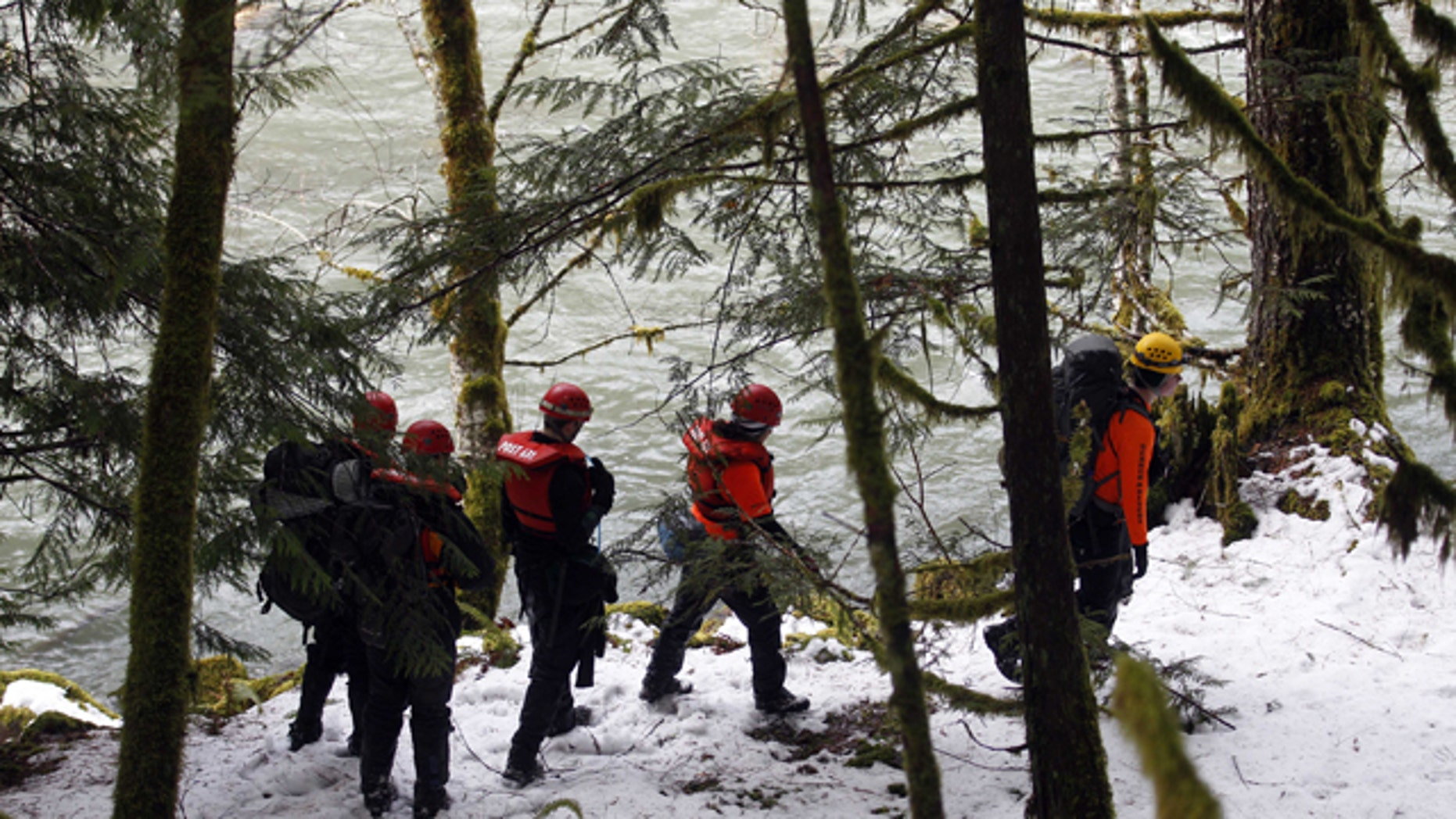 Jan. 23, 2012: Members of the Multnomah County Sheriff Search and Rescue team search along the Clackamas River for a 6-year-old who had fallen into the stream and was swept on downriver in Mount Hood National Forest, near Estacada, Ore.