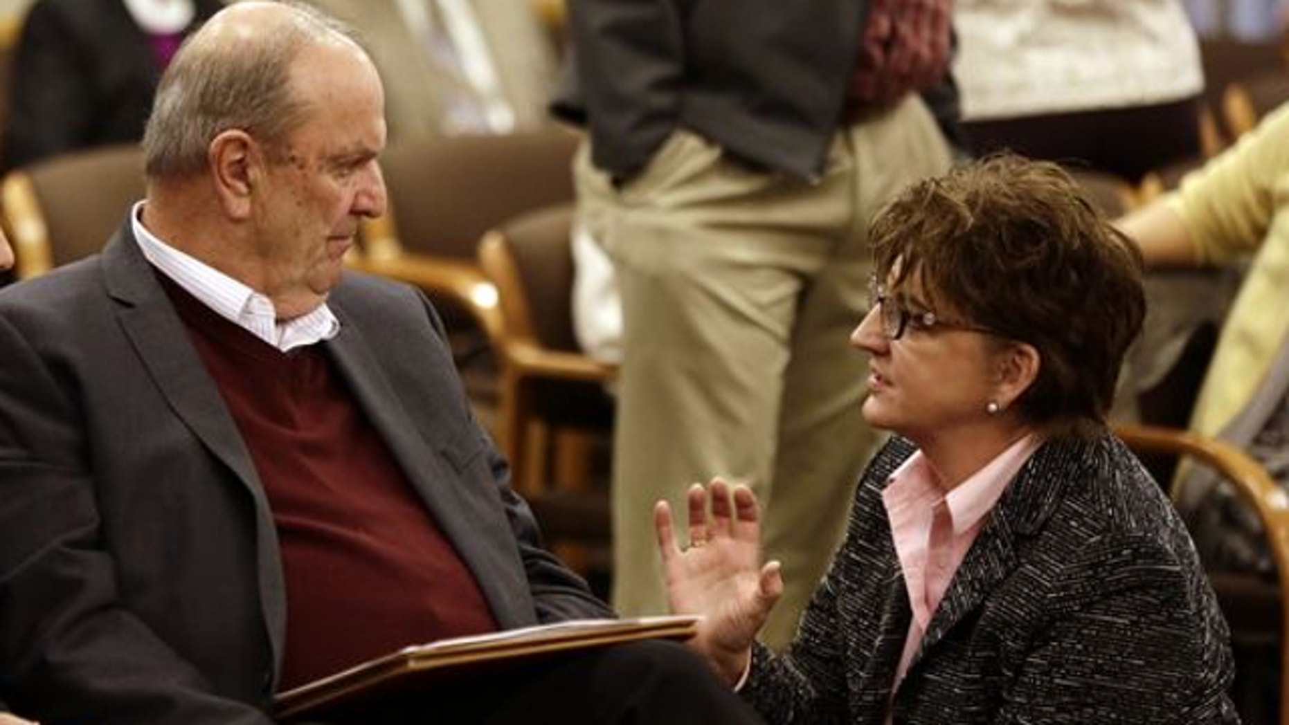 FILE: Nov. 20, 2013: Cover Oregon executive director Rocky King, left, confers with Oregon Health Authority Chief Information Officer Carolyn Lawson before appearing at a Joint Interim Committee on Legislative Audits, Information Management and Technology in Salem, Ore.