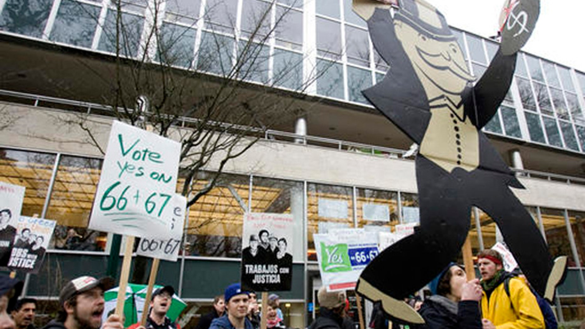 In this Jan. 22, 2010 file photo, supporters of Oregon's Measures 66 and 67, designed to raise taxes on high-income earners and corporations, hold a rally in Portland, Ore.