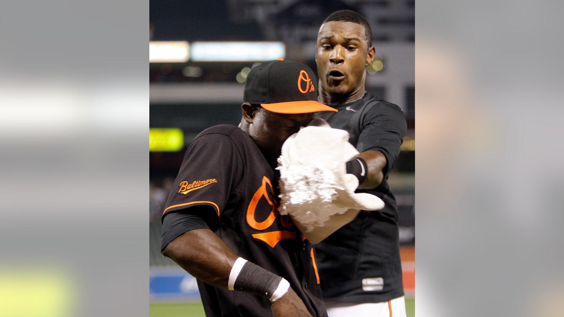 Felix Pie, left, is hit in the face with a shaving cream pie by Orioles teammate Adam Jones.