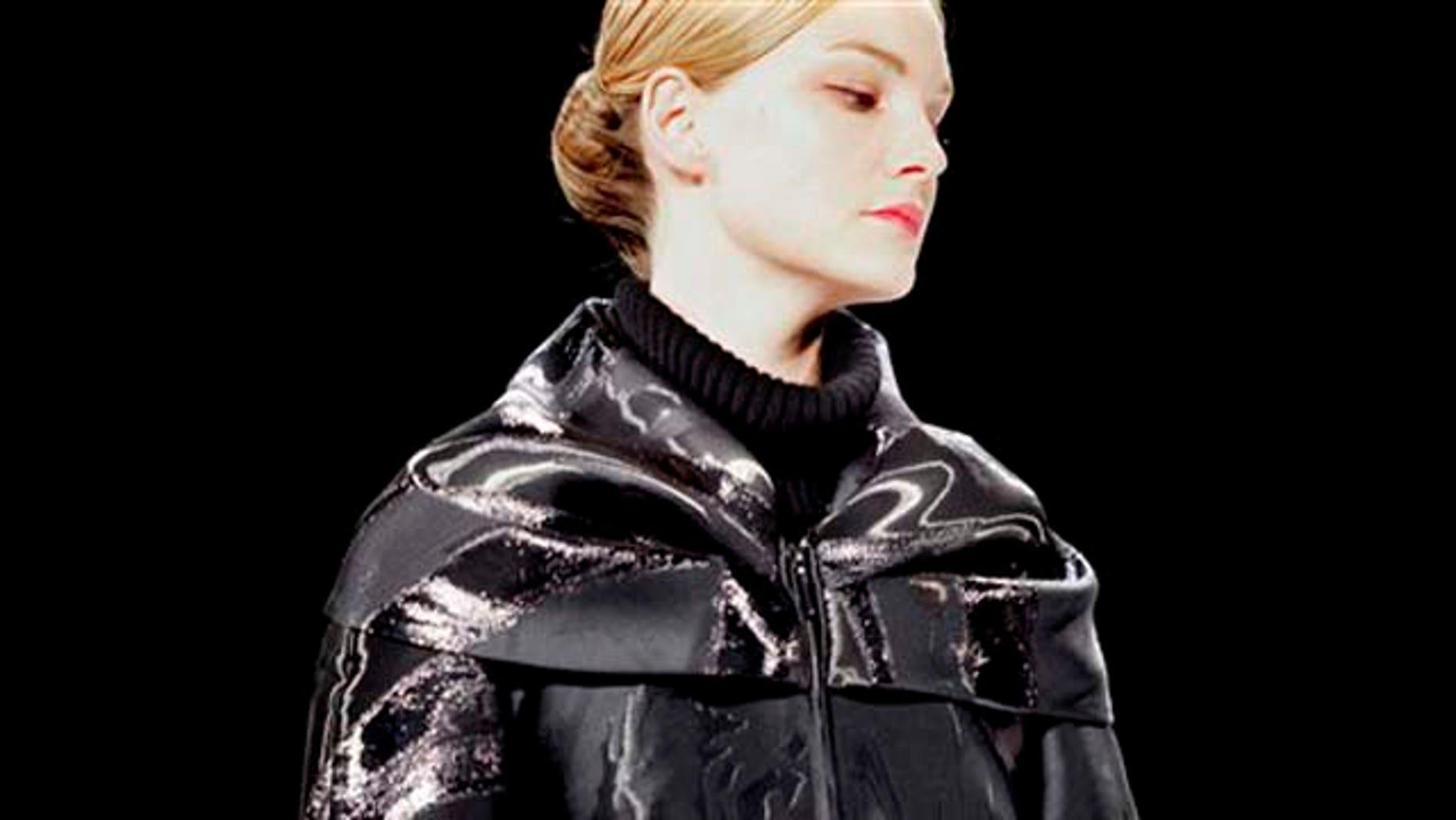 Fashion from the Fall 2011 collection of Carolina Herrera is modeled on Monday, Feb. 14, 2011 in New York.  (AP Photo/Bebeto Matthews)