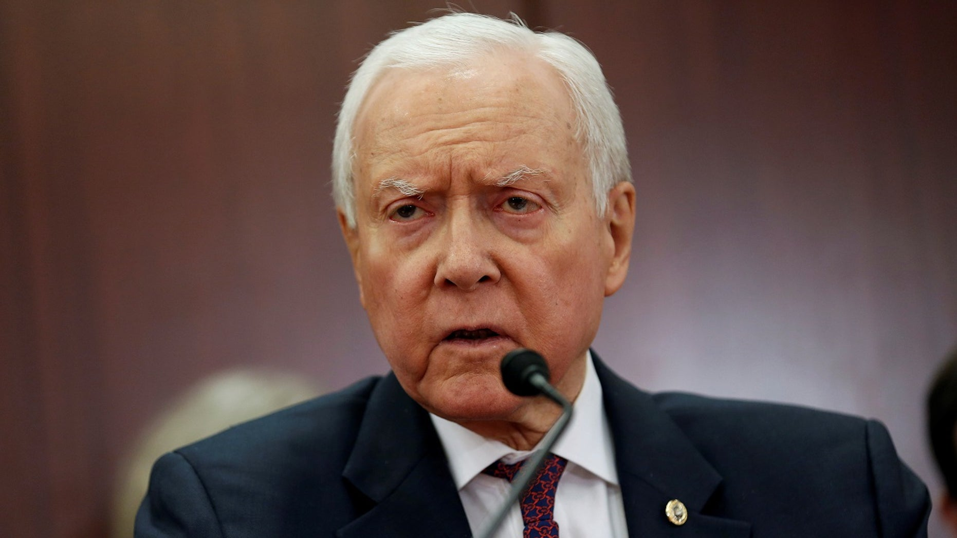The chairman of the Senate Finance Committee, Orrin Hatch, R-Utah, at a House-Senate conference meeting last month. He will not seek re-election in 2018, he announced.