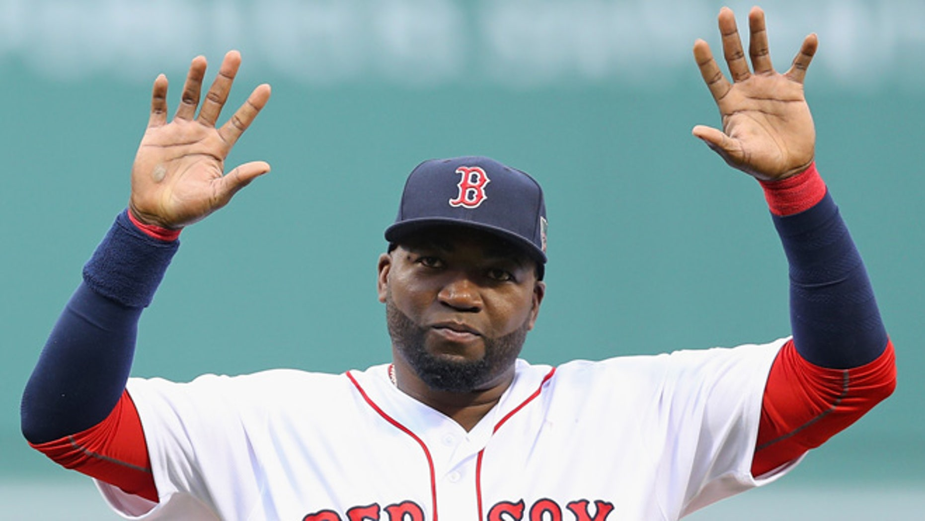 BOSTON, MA - OCTOBER 02:  David Ortiz #34 of the Boston Red Sox acknowledges the crowd during the pregame ceremony to honor his retirement before his last regular season home game at Fenway Park on October 2, 2016 in Boston, Massachusetts.  (Photo by Maddie Meyer/Getty Images)