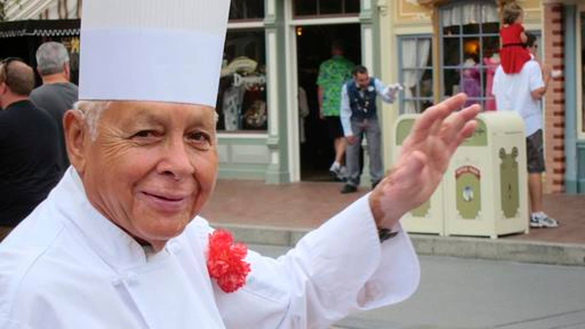 Oscar Martinez greets diners at the Carnation Cafe at Disneyland in Anaheim, Calif. Martinez, 81, is set to celebrate his 60th anniversary at the park  this month.