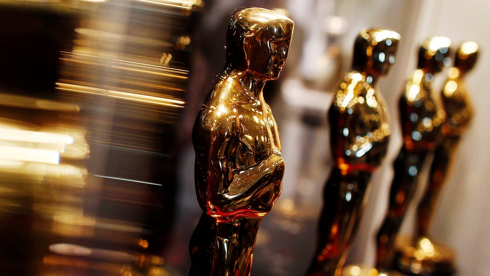 """FILE -- Oscar statuettes are displayed at the """"Meet the Oscars"""" exhibit in New York February 25, 2010."""