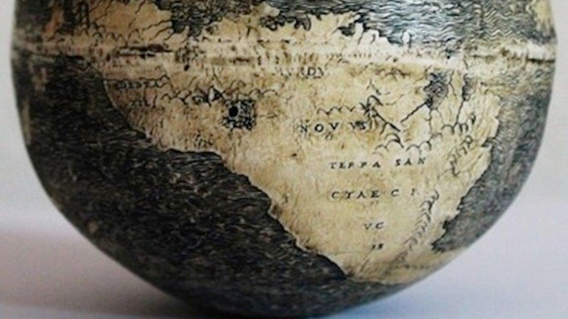 "The New World on the ostrich egg globe, which bears three names: ""TERRA DE BRAZIL,"" ""MVNDVS NOVVS, and ""TERRA SANCTAE CRVCIS."""