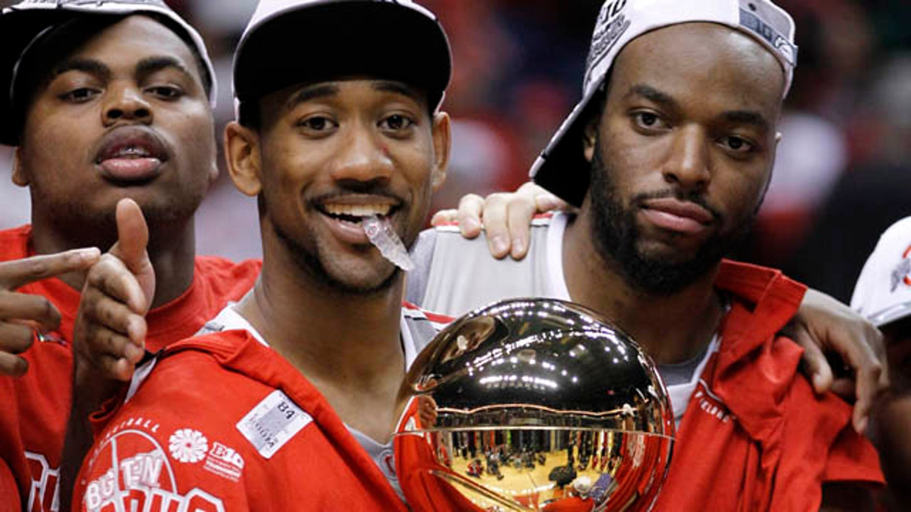 March 13: Ohio State forward Dallas Lauderdale, right, and David Lighty carry the championship trophy as Deshaun Thomas, left, looks on after Ohio State defeated Penn State 71-60 in an NCAA college basketball game in the championship of the Big Ten Conference tournament in Indianapolis. (AP)