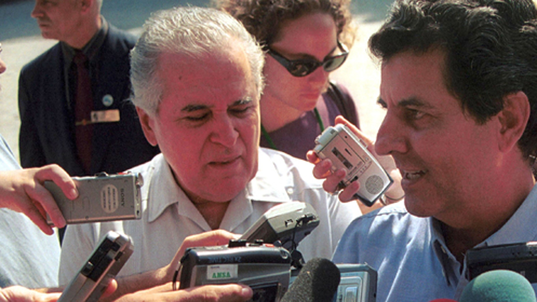 405296 02: Cuban dissidents Elizardo Sanchez (L) and Osvaldo Paya (R) speaks to the news media after a talk with former U.S. President Jimmy Carter May 13, 2002 in Havana, Cuba. The dissidents spoke with Carter about Cuba's current human rights situation and asked him to start a dialogue with the U.S. Carter is the first U.S. president, in or out of office, to visit Cuba since Castro came to power in 1959. (Photo by Jorge Rey/Getty Images)
