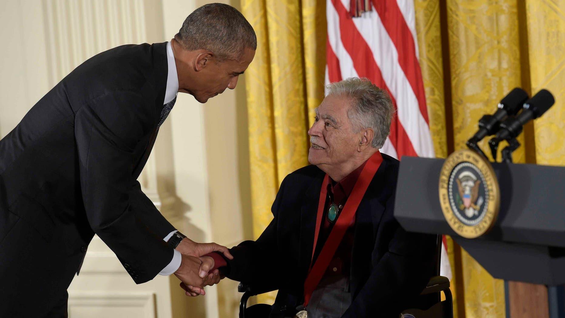 President Barack Obama shakes hands with author Rudolfo Anayaon Thursday, Sept. 22, 2016.