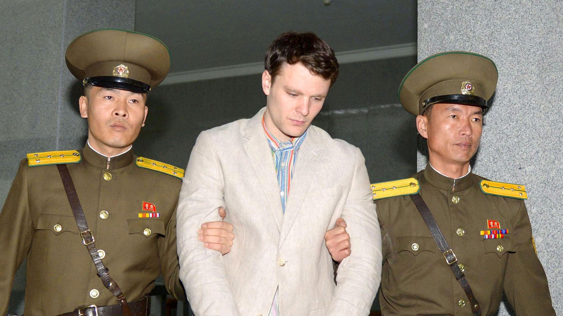 Otto Frederick Warmbier (C), a University of Virginia student who was detained in North Korea, is taken to North Korea's top court in Pyongyang, North Korea, in this photo released by Kyodo March 16, 2016.