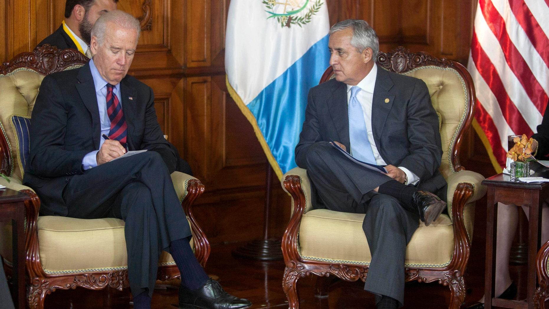 U.S. Vice President Joe Biden and Guatemala's President Otto Perez Molina in Guatemala City, Friday, June 20, 2014.