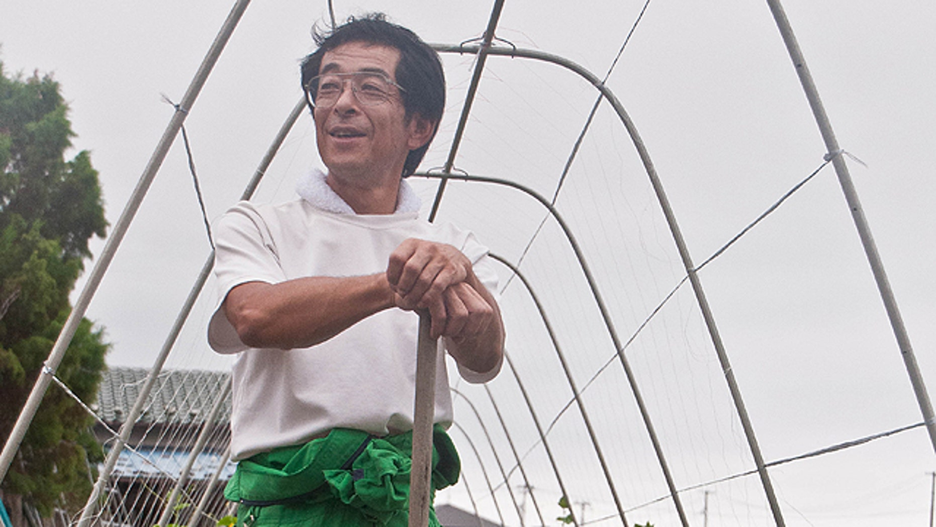 Like many local farmers who survived, Hirofumi Ouchi was told that if he left his land alone the government would fix it within a year, and provide insurance money.