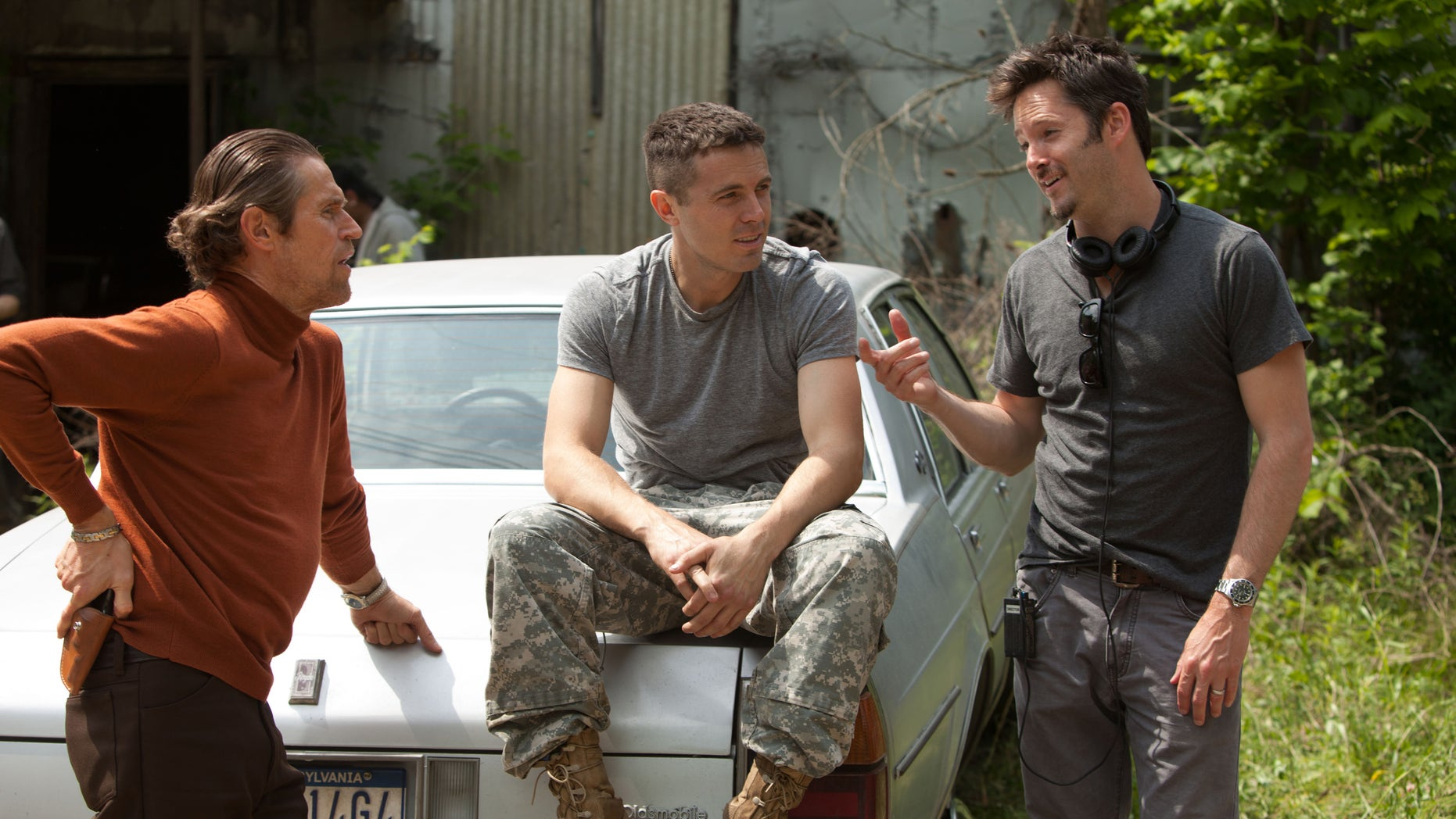 "This image released by Relativity Media shows actors Willem Dafoe, from left, Casey Affleck and director Scott Cooper on the set of ""Out of the Furnace."""