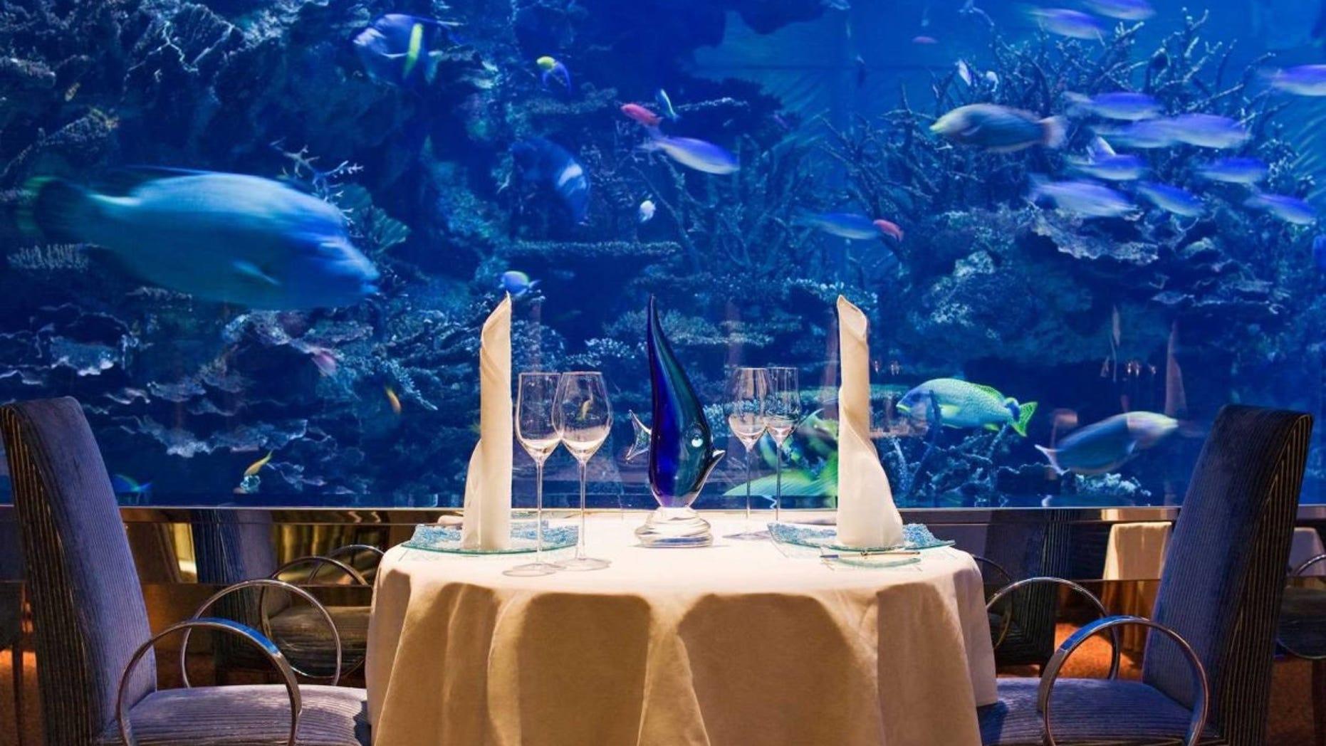Outlaw's at Al Mahara, at Jumeirah, Burj Al Arab has a floor ceiling aquarium